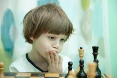 Boy playing chess Royalty Free Stock Photo