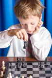 Boy playing chess Stock Photo