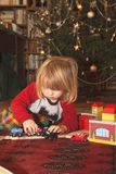 Boy playing with chrismas gift Royalty Free Stock Photography