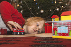 Boy playing with chrismas gift Royalty Free Stock Photo