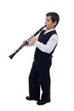 Boy playing on the clarinet Royalty Free Stock Photo
