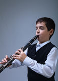 Boy playing on the clarinet Stock Image
