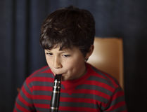 Boy playing clarinet Royalty Free Stock Photography