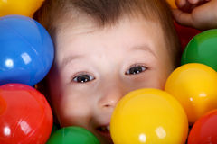Boy playing in colorful balls playground Stock Image