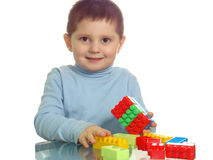 Boy playing with colorful bricks smiling. Isolated Royalty Free Stock Photography