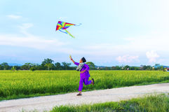 Boy playing colorful kite Royalty Free Stock Images