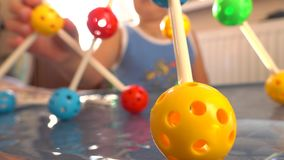 Boy playing with colorful plastic construction set. Balls and pins. 4K close up video. Unrecognizable little boy playing with colorful plastic construction set stock video footage