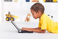 Boy playing computer Stock Image