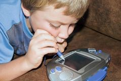 Boy Playing a Computer Game Stock Image
