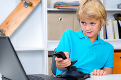 Boy is playing computer game Stock Photos