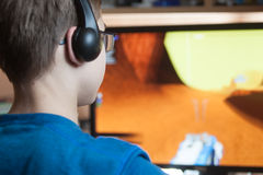 Boy is playing a computer game Stock Photo