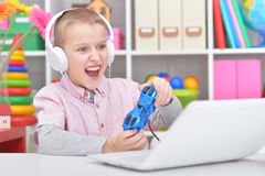 Boy playing a computer game Stock Images