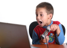 Boy playing computer games Stock Photography