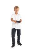 A boy playing computer games. A boy wearing a white shirt playing computer games Stock Photo