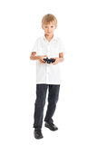 A boy playing computer games. A boy wearing a white shirt playing computer games Royalty Free Stock Photography