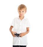 A boy playing computer games. A boy wearing a white shirt playing computer games Stock Image