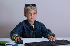 Boy playing at computer games Stock Photography