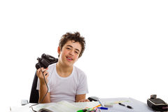 Boy playing with console controller and homework Royalty Free Stock Photography