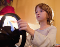 Boy Playing Console Game. Boy Playing Racing Console Game with Steering Wheel Stock Photos