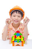 Boy playing construction blocks Royalty Free Stock Photos