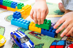 Boy playing constructor. In the children`s room royalty free stock photo
