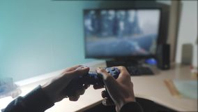 Boy is playing on controller joystick gamepad the console computer. playing video game console on tv. Hand hold new. Joystick online video console on tv. Gamer stock footage