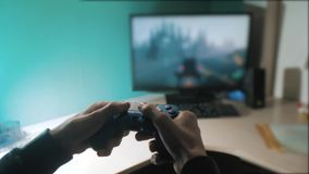 Boy is playing on controller joystick gamepad the console computer. playing video game console on tv. Hand hold new. Joystick online video console on tv stock video footage