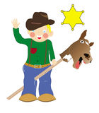 Boy playing the cowboy Stock Photography