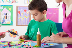 A boy playing creative colourful games Stock Photos