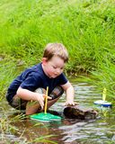 Boy playing in creek Stock Photography