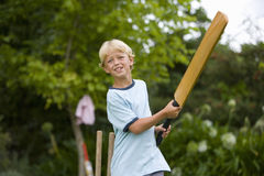 Boy (10-12) playing cricket, low angle view Stock Photos