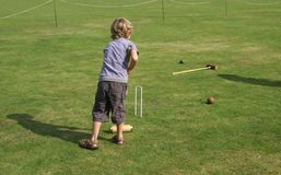 Boy playing croquet Royalty Free Stock Photos