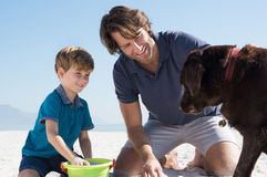 Boy playing with dad and dog Royalty Free Stock Photos
