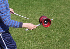 Boy playing diabolo. Just hands and diabolo included, plenty of copy space on the right Royalty Free Stock Photo