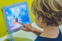 Boy playing with digital tablet. Children and technology concept royalty free stock image