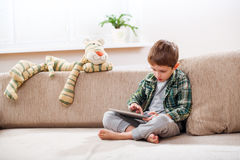 Boy playing with digital tablet Royalty Free Stock Photography