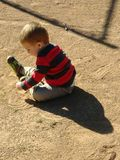 Boy playing in dirt Stock Photo