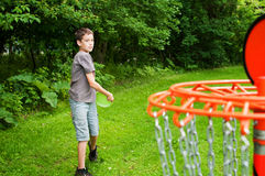 Boy playing disc golf Stock Photo