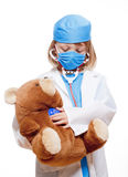 Boy playing a doctor Stock Photos