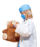 Boy playing a doctor Royalty Free Stock Image