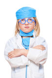 Boy playing a doctor Stock Images