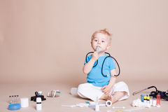 Boy playing in the doctor in the hospital Stock Photo