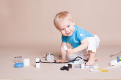 Boy playing in the doctor in the hospital Stock Photos