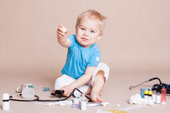 Boy playing in the doctor in the hospital Royalty Free Stock Images