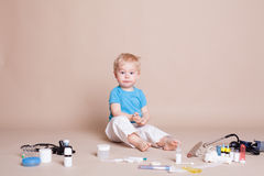 Boy playing in the doctor in the hospital Stock Images