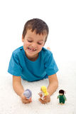 Boy playing domestic violence game with puppets Stock Photo