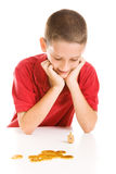 Boy Playing Dreidel. Adorable boy playing dreidel during the Hanukkah celebration. Isolated on white. Hebrew symbols on the coins are generic, not copyrighted