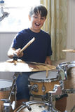 Boy Playing Drum Kit At Home Royalty Free Stock Image