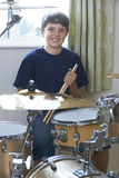 Boy Playing Drum Kit At Home Royalty Free Stock Images