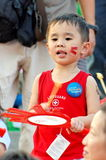 Boy playing with drum during NDP 2009 Royalty Free Stock Images